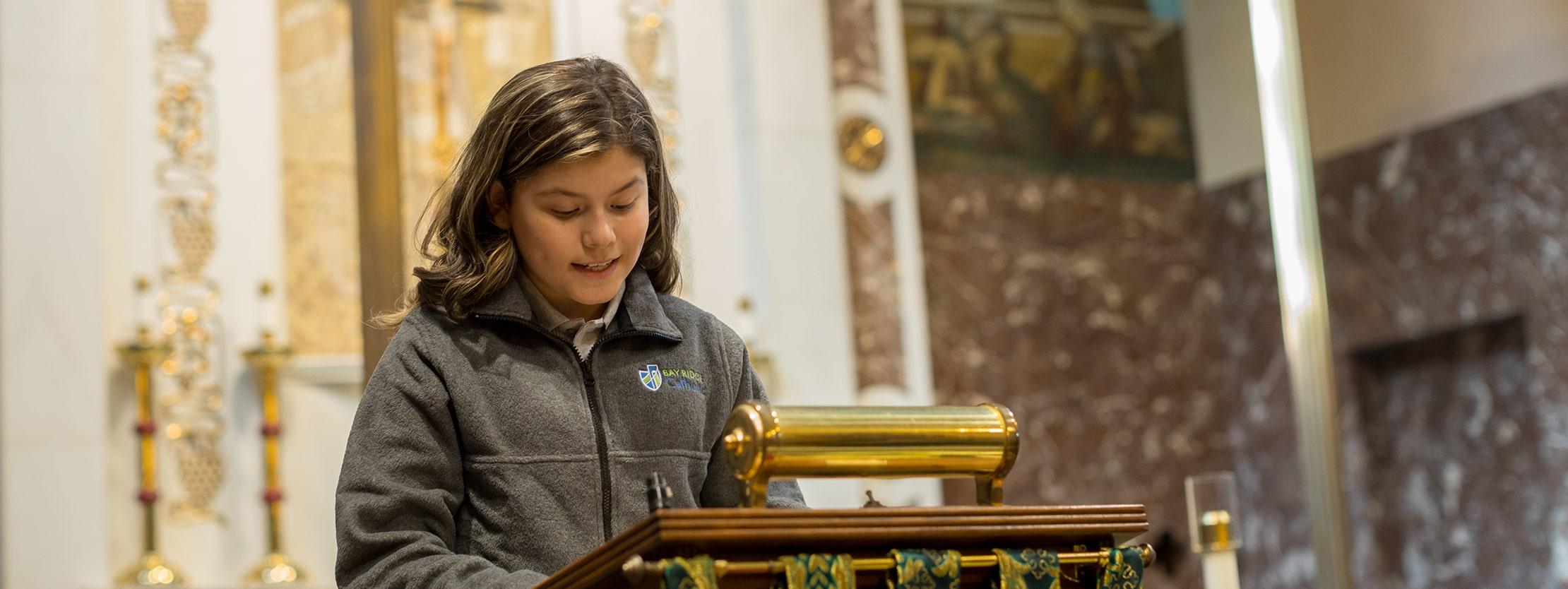 Bay Ridge Catholic student giving reading in church